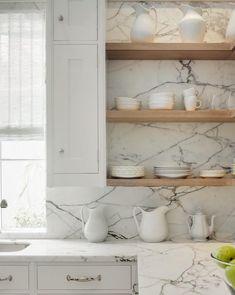 Stone slab counters & backsplash + floating wood shelves