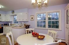 Adorable dinette and kitchen where we installed these double hung windows with grilles...