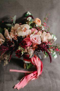 Photographer: Michele M. Waite Photography; Rustic Red Seattle Wedding from Michele M. Waite Photography - red bridal bouquet