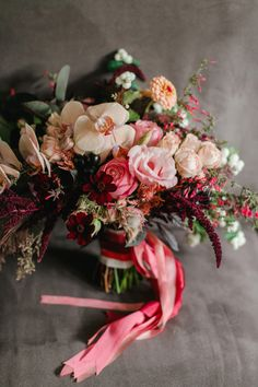 Rustic Red Seattle Wedding from Michele M. Waite Photography - red bridal bouquet