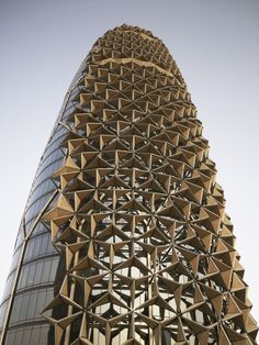 Al Bahar responsive facade in Abu Dhabi by AEDAS (I would like to see this with cascading hexagonal shapes wrapping around a better looking building)
