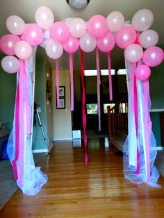Photo booth for baby shower  arch made out of PVC pipe, added tulle fabrics and balloons