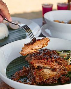 "Rendang is known as a staple dish from West Sumatra and Malaysia this dish has become one of ""World's 50 Most Delicious Foods"" (Based on CNN readers online poll). . This dish usually used meat or chicken as the main ingredient but here at @WarungCenana we found something different a Beef Ribs Rendang!! This succulent ribs were cooked to perfection in rich rendang sauce that create a unique and tasteful dish. --- Warung Cenana Jalan Labuan Sait Pecatu Uluwatu Bali --- . . . . . #foodcious…"