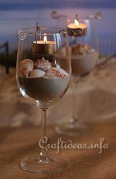DIY Beach wine glass candle holders wedding favor/ table centerpieces all in one. one for each guest & possibly monogram the glass with a simple DIY project! Wine Glass Candle Holder, Votive Holder, Glass Votive, Mini Terrarium, Do It Yourself Wedding, Seashell Crafts, Beach Crafts, Luau Party, Beach Party