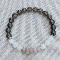 Luxury three color wrist mala made with high quality smoky quartz , 6 moonstone and 5 sunstone. This color combination is calming and soothing. It makes a great meditation accessories for your yoga practice or just a fashion jewelry. I strung them on strong elastic cord to make it easier put on and take off. Pick a desire size or let me know your custom size in the note box during check out.  I only use genuine gemstone because only genuine gemstone has the healing property for your needs…