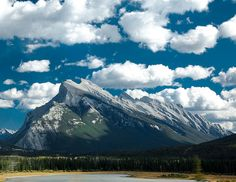 Mount Rundle - Banff by renata_souza_e_souza, via Flickr  I climbed this mountain when I was 19. Took me all day to climb and when it started to rain took 30 mins to get down to the bottom! I slid most of the way down and could barely walk by the time I was down.