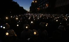 Coal miners demonstrate with their lamps lit through the streets of the city of Leon, northern Spain, on June 12, 2012.Spanish coal miners are staging a nationwide strike action organized by unions opposed to subsidy reductions from 300 million euros to 110 million euros, Agence France Presse reports.  [Credit :Cesar Manso / AFP / Getty Images]