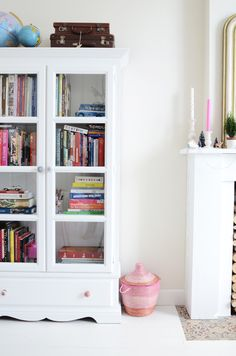 Give a bookcase a makeover and use it to display not only books but pretty decor as well