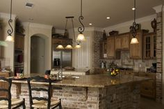 Remodel idea - cover side panels with fake brick? Refinish cabinets - add windowed doors for variety.  Like the lights.......black accents by ava