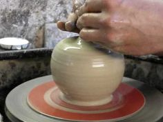 Attempting to make a pottery Apple shaped clay pot on the potters wheel throwing demo - YouTube
