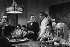 Humphrey Bogart in Casablanca as Rick at roulette table 24x36 Movie Poster