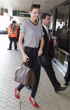 Miranda Kerr looks like a modern-day Audrey Hepburn in her striped T-shirt, jeans and red pumps. Miranda Kerr Style, Waterfall Jacket, Bags Online Shopping, Red Pumps, Red Shoes, Street Look, Street Style, Louis Vuitton Shoes, Clothing Size Chart