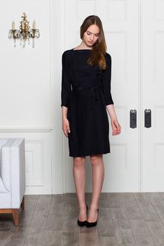 Great black wrap dress - love that it can be high neck or v neck.
