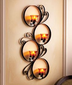 Metal wall candle holder.........beautiful idea.....keep your metal craft tools rolling!!.....www.metalcraft-tools.com
