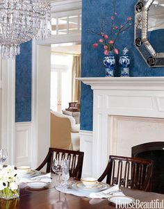 Prussian blue Venetian plaster walls in a traditional dining room. Design: Allison Caccoma.