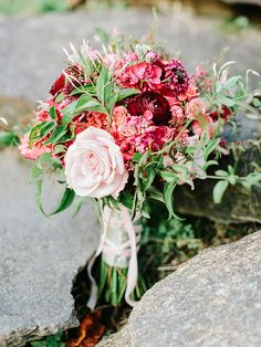 berry toned bouquet, photo by Amy Arrington http://ruffledblog.com/georgia-wedding-with-the-ultimate-naked-cake #weddingbouquet #fallwedding