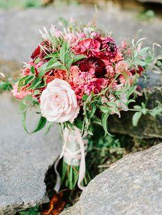 berry toned bouquet, photo by Amy Arrington http://ruffledblog.com/georgia-wedding-with-the-ultimate-naked-cake #weddingbouquet #fallwedding