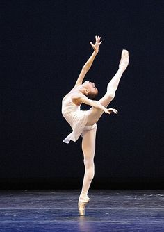 this is an example of contrast because the black background and the white ballerina are shown as opposites very well in this picture