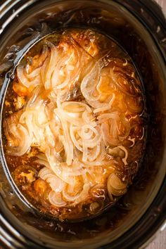 Slow Cooker Pork Chops and Onions are tangy and tender, great for a summer dinner.
