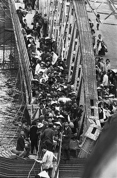 19 Feb 1968, South Vietnam --- Hoards of Vietnamese make their way across the wreckage of a bridge which spans the Perfume, or Huong, River.   #VietnamWarMemories