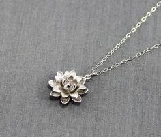 Lotus Necklace, Silver Lotus Blossom Charm on a Sterling Silver Cable Chain, Dainty Everyday Necklace, Lotus Flower, Bridesmaid Jewelry by LadyKJewelry on Etsy https://www.etsy.com/listing/190524339/lotus-necklace-silver-lotus-blossom