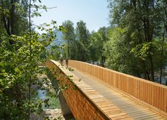 wooden footbridge,Vlatka Ljubanovic, bicycle path, bridge design, wooden bridges, arching bridge design, bridge Slovenian village, timber planks and shingles bridge, Sava River bridge, spruce wooden bridge, timber bridge,