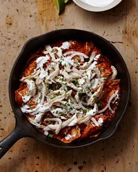 Chipotle Chilaquiles Recipe on Food & Wine| Chilaquiles is a basic Mexican dish created to use up leftovers like tortillas, chiles, shredded chicken and cheese. Rick Bayless keeps the recipe simple by doctoring canned tomatoes with canned chipotles in adobo, available at Latin grocers and many supermarkets.