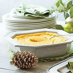 Cheesy Grits Soufflé | Turn a classic Southern dish into a light, fluffy soufflé for the ultimate holiday brunch. | SouthernLiving.com
