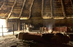 Interior of a reconstructed roundhouse at Castell Henllys Iron Age hillfort