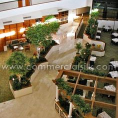 Commercial Silk Int'l created an atrium design with large artificial trees that took into consideration the client's design objectives, light levels and other environmental factors. http://www.commercialsilk.com/artificial-plant-case-study_silk-indoor-plants-for-radisson-and-sheraton-hotel-atriums_4.aspx