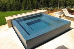 Both the pool and spa have an all-glass tile finish. Description from luxurypools.com. I searched for this on bing.com/images