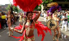 go to the: Notting Hill carnival: sunshine brings smile to revellers    Sun comes out for Europe's biggest street festival, while police report 104 arrests by early afternoon