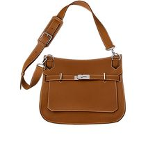 """Jypsiere 34 Unisex shoulder bag in gold taurillon clemence leather (size 34) Measures 13.5"""" x 10"""" x 6"""".<br />Front flap closure with swivel clasp. Adjustable strap with 5 holes and a shoulder pad for comfort. Inside includes front zip pocket, back large pocket with gusset and small pocket for cell phone. Gold"""
