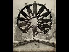 """Man on Rooftop with Eleven Men in Formation on His Shoulders"""", 1930"""