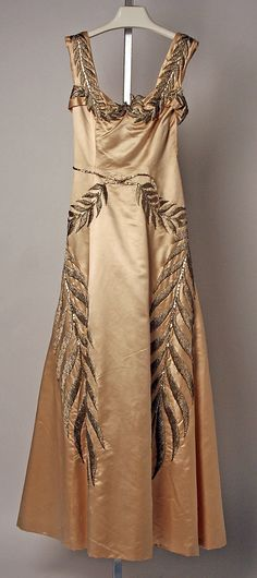 """House of Chanel (French, founded 1913)  Designer: Gabrielle """"Coco"""" Chanel (French, Saumur 1883–1971 Paris) Date: 1939 Culture: French Medium: silk, metallic thread"""