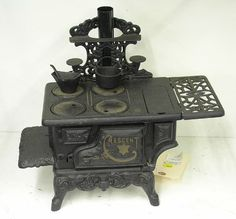 Crescent cast iron miniature kitchen cook stove with coal hod and iron kettle, 11''h x 14''w.