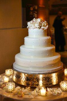 Ivory #weddingcake with Swiss Dots   Marie Labbancz Photography   Brides.com