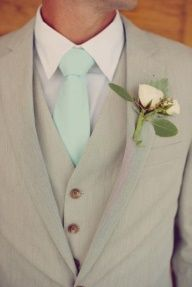 Oh my lanta..i may have just found the perfect one:) Gray suit with mint tie and blush pink flowers for the boutonnire