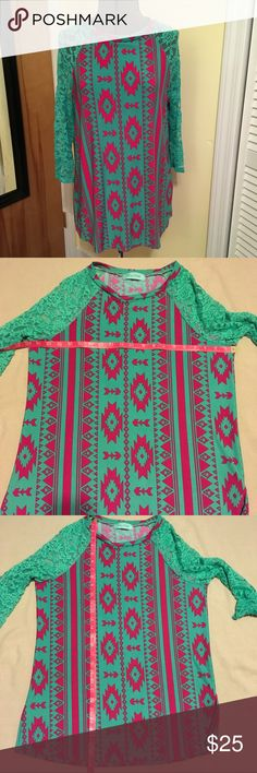 Filly Flair Aztec print top with lace sleeves Filly Flair Aztec print teal and pink top with lace sleeves  Comfortable & versatile knit fabric Has a few grizzlies on underarm as pictured, otherwise in Excellent used condition  Smoke free Feel free to make an offer Filly Flair Tops