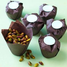 Spicy Lime Pistachio Nuts - Pistachios lend seasonal green color to this nut mix, but you could easily sub almonds or cashews. To package, layer two muffin liners to make a sturdy container and add your favorite nut mix. Punch circles out of cardstock. Fold down the flaps of the liners to cover the mix, and use a dab of hot glue to seal with a cardstock circle.