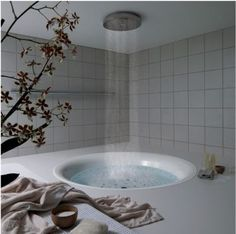 If I had this bath tub, it would definitely qualify for a favorite place! :-)  With a rain shower head too.  Love it!