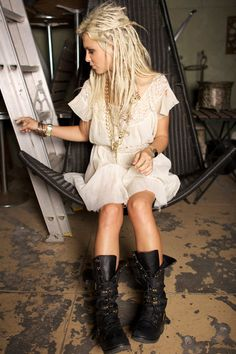 I love big industrial boots with feminine clothes! & I love everything about this picture!