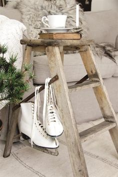 Great side-table use for an old step ladder…. and the ice skates add that warm winter charm