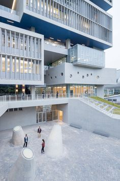 Blue-bottomed boxes protrude from Open Architecture's ocean research centre in Shenzhen