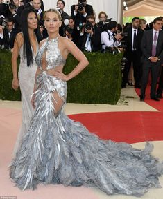 2016 Met Ball Gala N.Y (Please follow minkshmink on pinterest) Dramatic: Rita Ora stunned in a metallic feathery creation by Vera Wang...