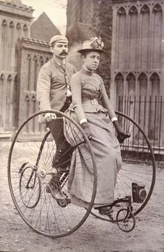 A picturesque image of a couple riding an impressively sized tandem (and a man with an impressively sized moustache) in Stockholm.