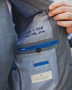 Signature Stitching: Both sets of the couple's initials, along with the wedding date, were embroidered inside Ross's Bespoke by Louis Purple suit jacket.