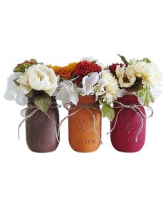 Everyone's favorite multi-purpose jar gets a holiday makeover with a coat of matte brown, burgundy, and burnt orange paint. Fill the pint-size trio with flowers and use as a centerpiece or to dress up the table in your entryway.