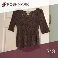 Three quarter lace blouse Tan three quarter lace American Rag blouse. Has four buttons at the top and flares open under the breasts. A little longer in the back. American Rag Tops Blouses
