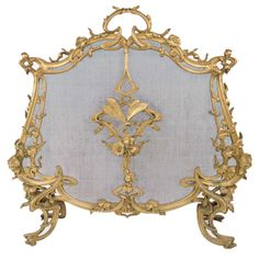View this item and discover similar for sale at - A French Art Nouveau gilt bronze fire screen decorated with highly organic whiplashes amongst poppies and further decorated with a dragonfly in flight Art Nouveau Interior, Art Nouveau Furniture, Modern Fireplace Tools, Fireplace Screens, Baroque Art, Room Screen, Wood Arm Chair, Architectural Elements, French Art